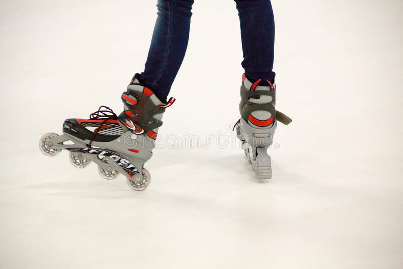 Close up view, on white, of inline skate or rollerblade on the ice rink. Close up view, on white, of inline skate or rollerblade royalty free stock photo