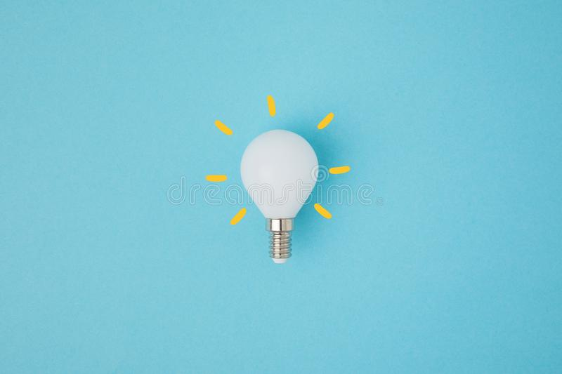 Close up view of white light bulb with yellow lines royalty free stock image