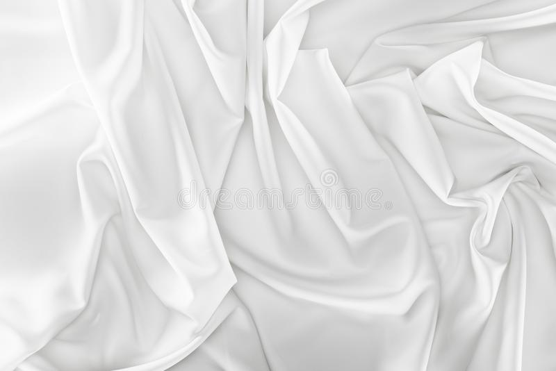 Close up view of white soft silk fabric. As backdrop royalty free stock image