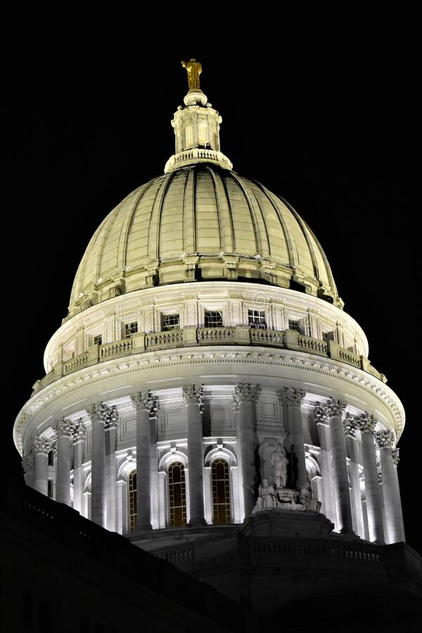 Close up view of WI State Capitol Dome and Statue Wisconsin. Detail view of the Wisconsin State Capitol Dome at night with the golden statue Wisconsin at the top royalty free stock images