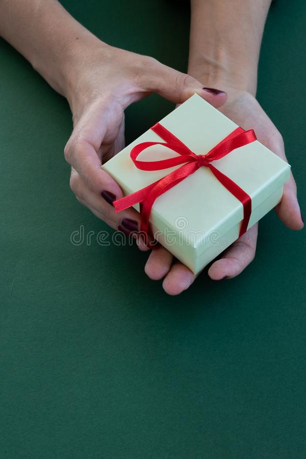 Close up view of woman hands holding a gift box royalty free stock photography