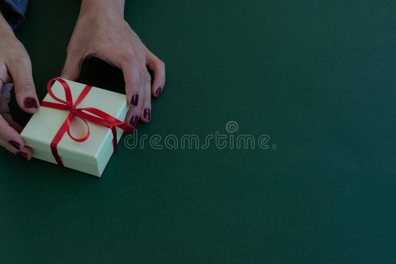 Close up view of woman hands holding a gift box royalty free stock photos