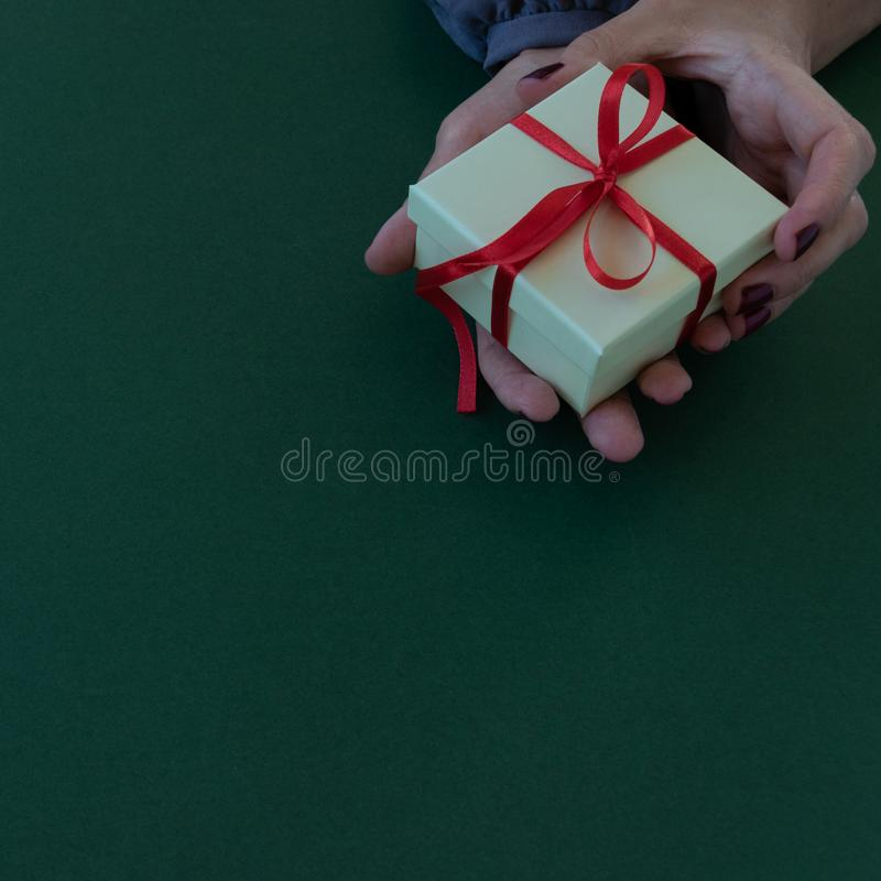 Close up view of woman hands holding a gift box royalty free stock images