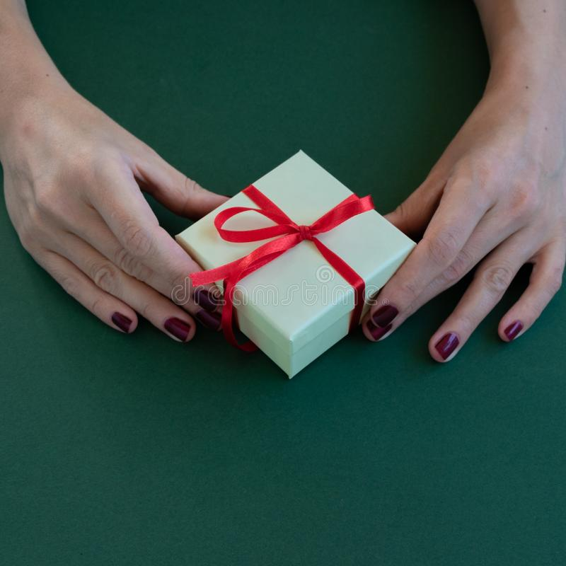 Close up view of woman hands holding a gift box royalty free stock photo
