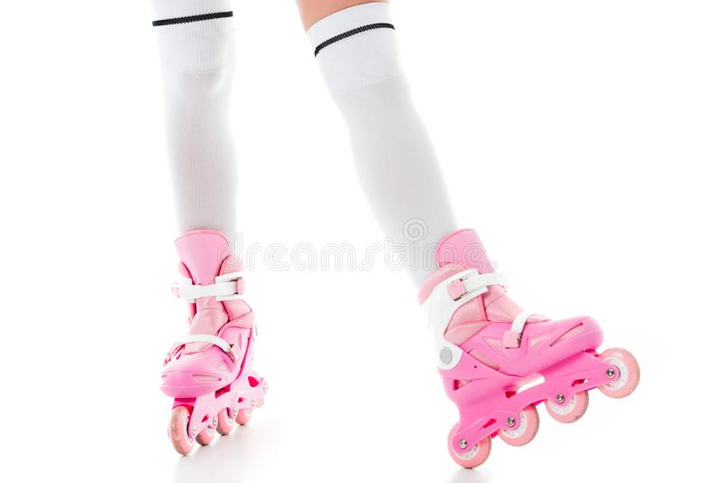 Close-up view of woman in pink inline roller skates isolated on white royalty free stock images