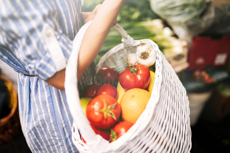 Close-up view of woman`s basket full of groceries royalty free stock photos