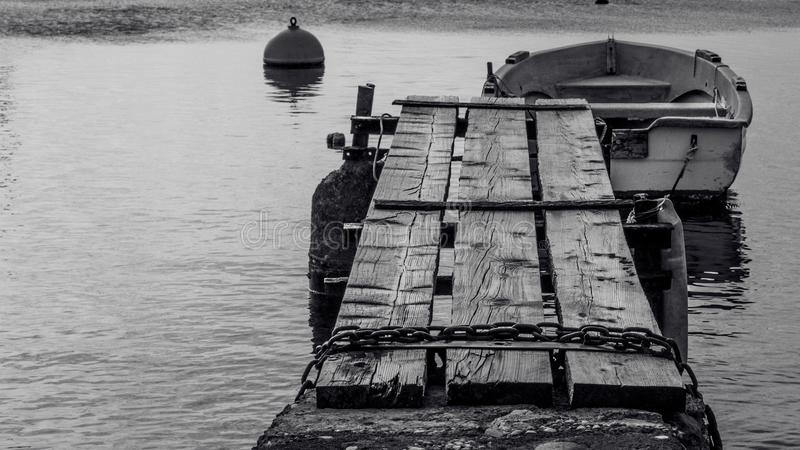 Close up view of wooden br4own bridge in a small port with few b royalty free stock image