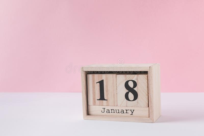Close up view of wooden calendar. Isolated on pink royalty free stock images