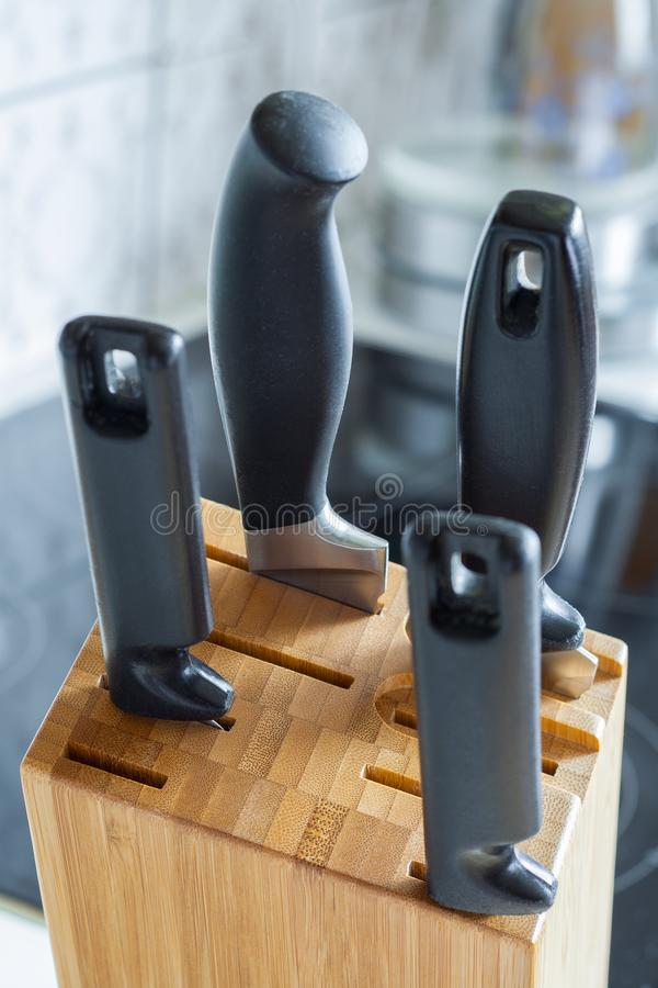 Close up view of a wooden stand with stab knives royalty free stock photos