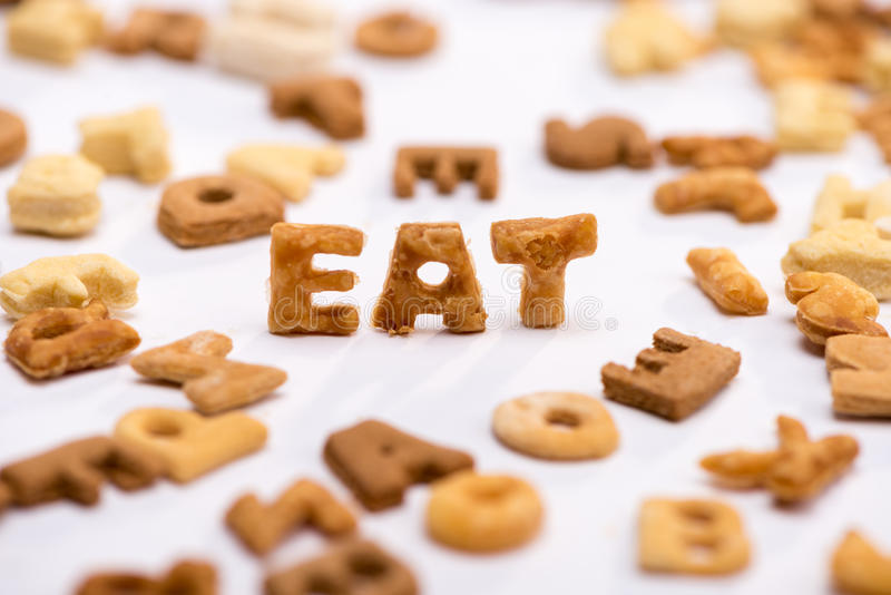 Close-up view of word eat and healthy breakfast cereal alphabet. On white royalty free stock photo
