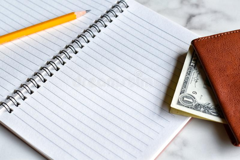 Close-up view, Writing notebook for earnings or expenses. royalty free stock image