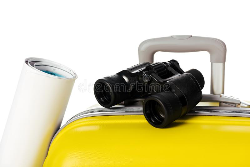close up view of yellow suitcase map and binoculars royalty free stock image