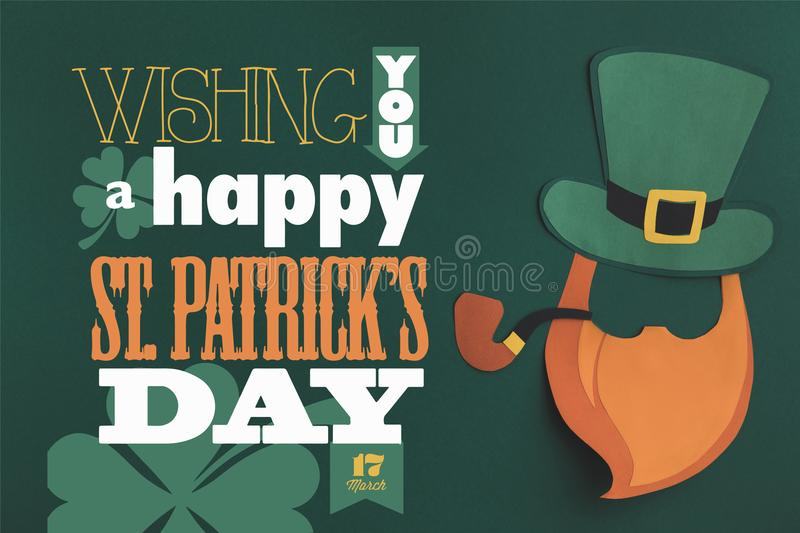 Close up view of you a happy st patricks day lettering on green background. Close up view of paper made green hat and beard with wishing you a happy st patricks stock image