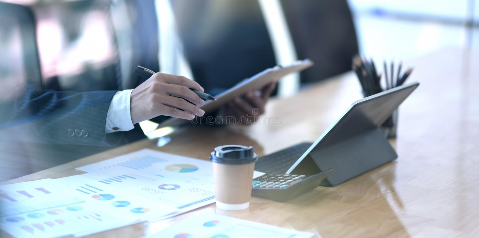 Close-up view of young businessman planing his project while using tablet stock image
