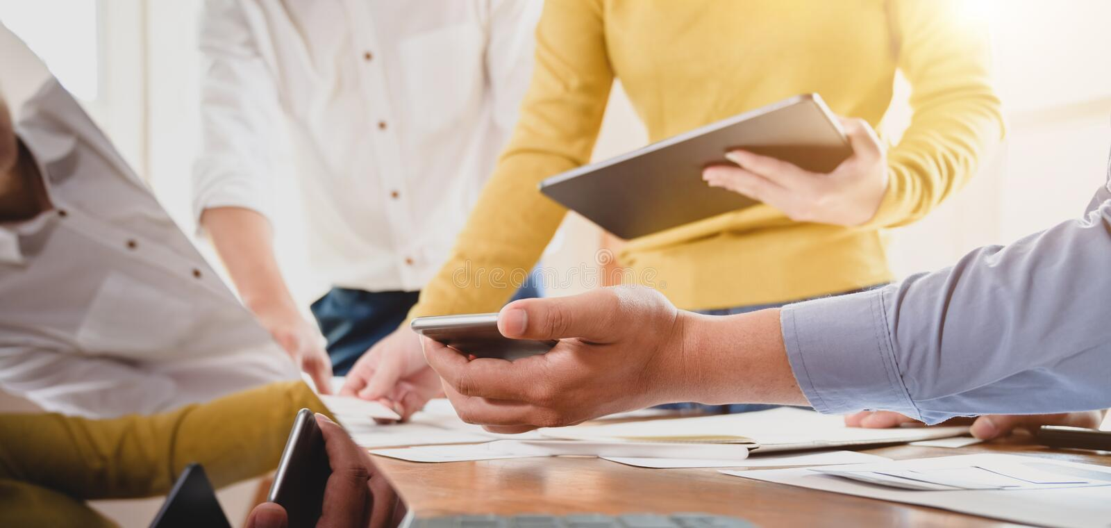Close-up view of young professional UX web developer team discussing on the project. Together stock photo