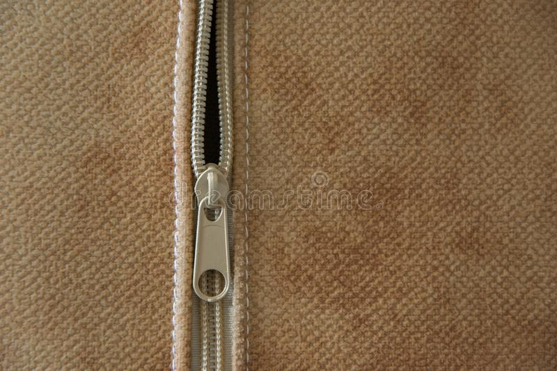 Close-up view of the zipper of a decorative pillow, concept - textile industry for furnishings royalty free stock photography