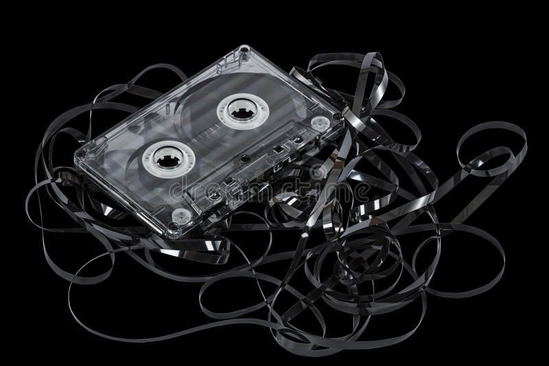 Close up of vintage audio tape cassette, isolated on black, with royalty free stock photos