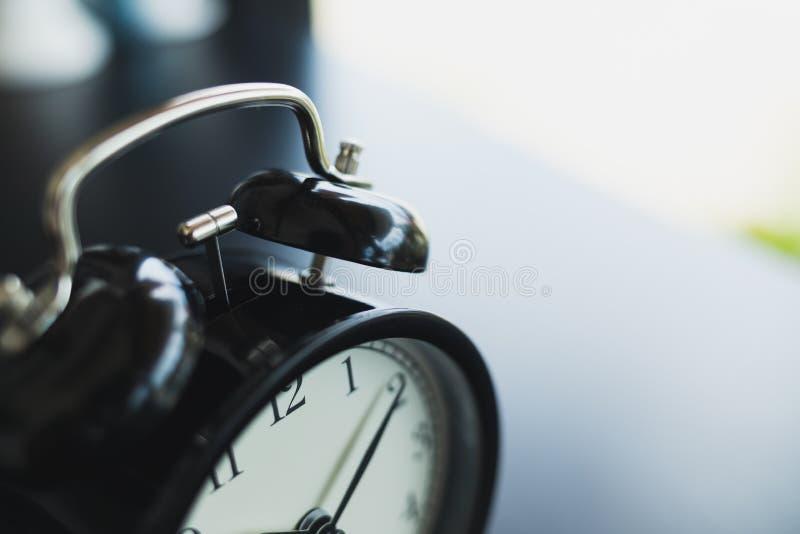 Close up vintage black alarm clock parts stock photography