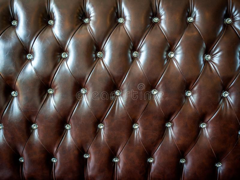 Close-up vintage brown leather button sofa texture royalty free stock images