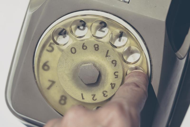 Close up of a vintage dial telephone. Close up of a vintage grey dial telephone stock photos