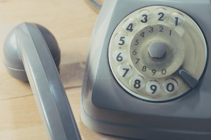 Close up of a vintage dial telephone. Close up of a vintage grey dial telephone royalty free stock image
