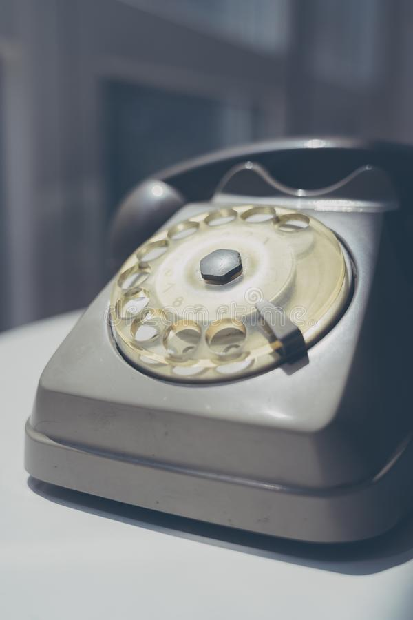Close up of a vintage dial telephone. Close up of a vintage grey dial telephone stock image