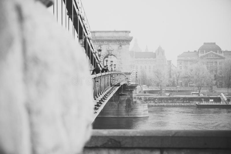 Close up of vintage metal fence of Chain Bridge in black white. Architecture construction background. Hungary, Budapest royalty free stock image