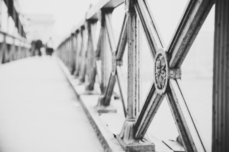 Close up of vintage metal fence of Chain Bridge in black white. Architecture construction background. Hungary, Budapest. Hungary royalty free stock photography