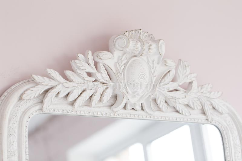 Close-up of a vintage mirror with decorative ornaments stock photo