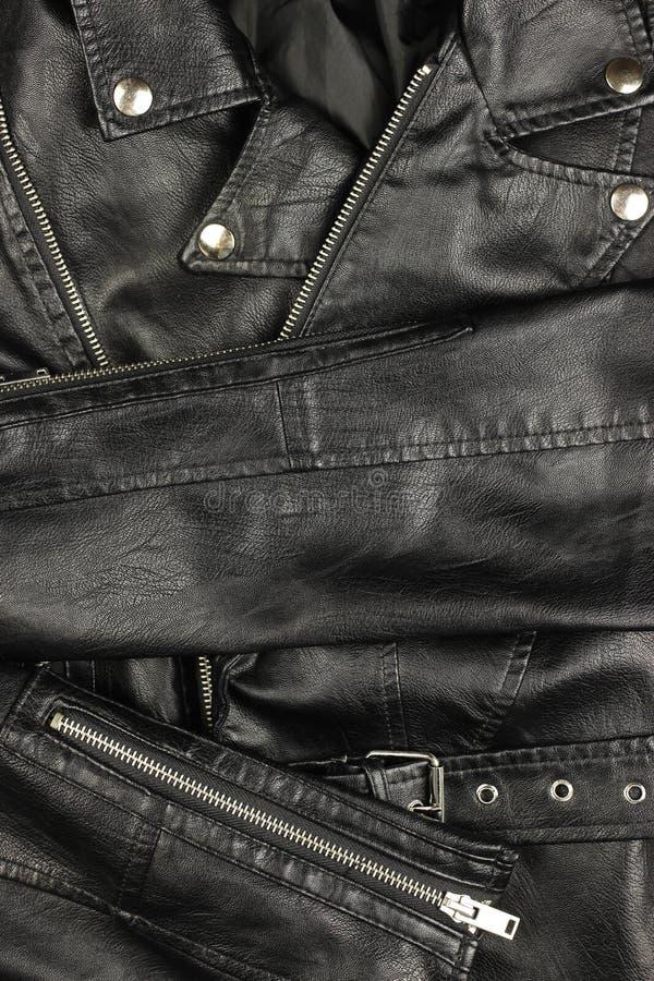 Close-up of vintage Moto black leather jacket details-collar, locks, rivets.  stock photo