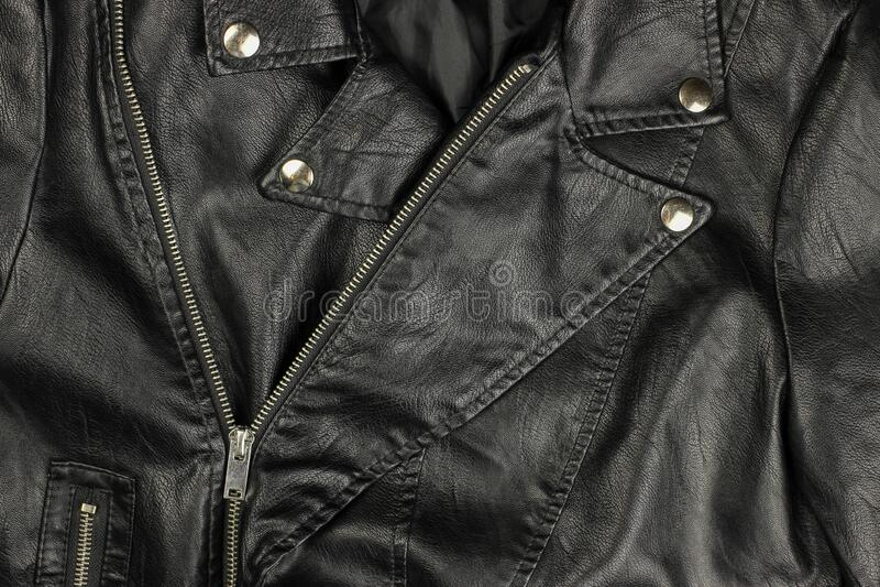 Close-up of vintage Moto black leather jacket details-collar, locks, rivets.  stock photos