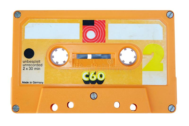 Close up vintage and old yellow audio cassette tape isolated on a white background stock images
