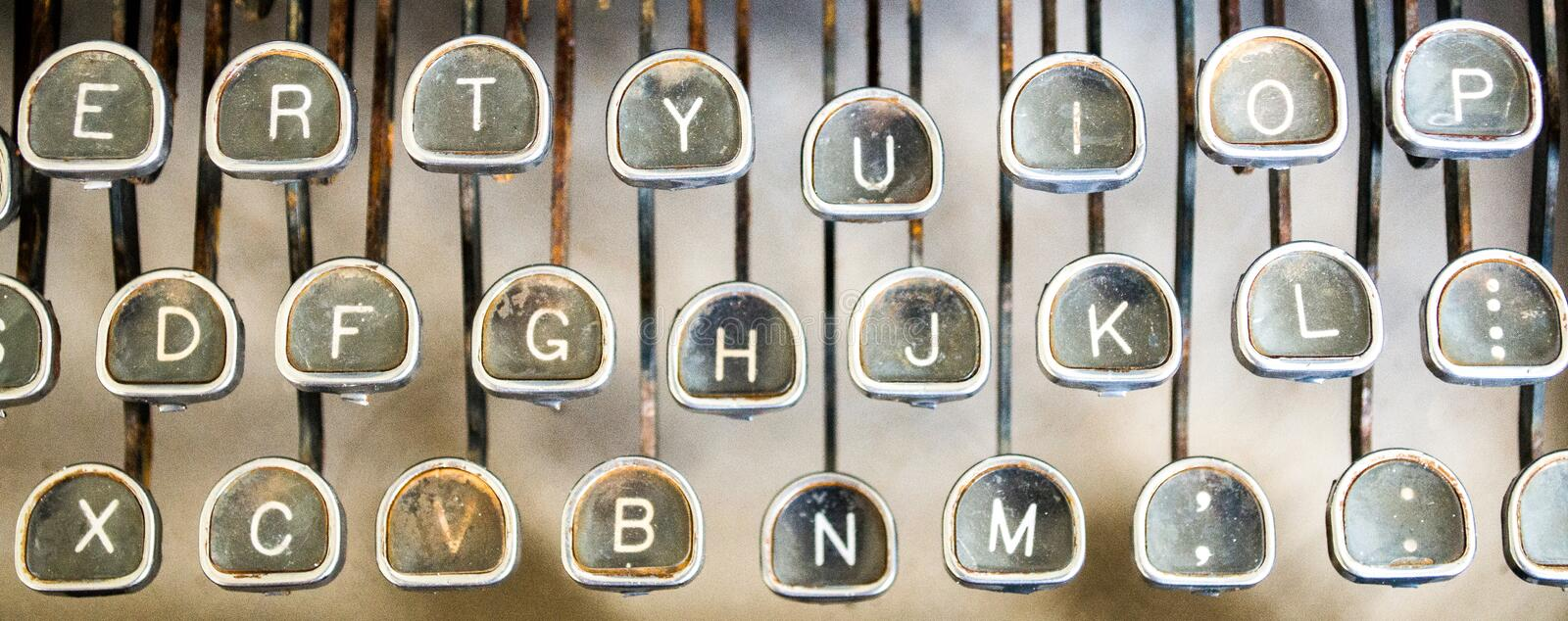 Close up of vintage rusted typewriter keys. Close up of three rows of vintage rusted manual black typewriter keys royalty free stock photo