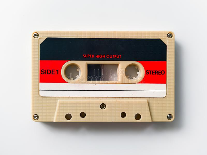 Vintage  tape cassette isolated on white background. Close up vintage  tape cassette isolated on white background, 1980s, 70s, 90s, aged, analogue, audio, blank royalty free stock images