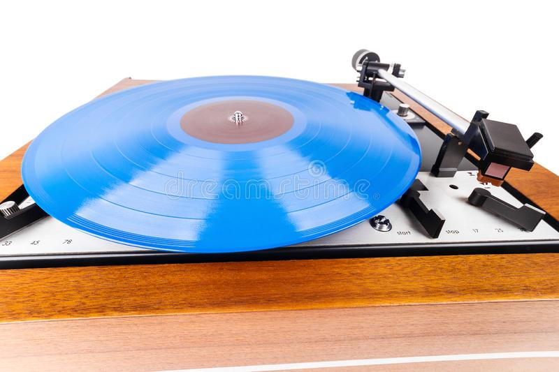 Close up of vintage turntable with a blue vinyl isolated on white royalty free stock image