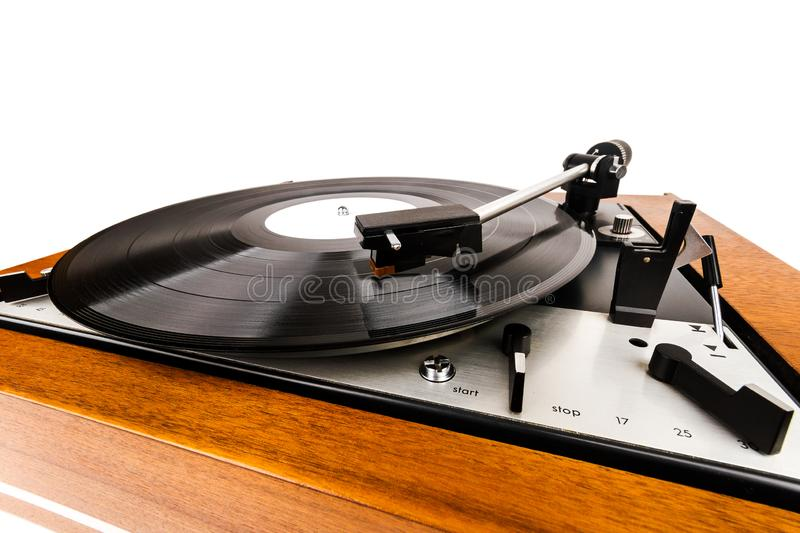 Close up of vintage turntable vinyl record player isolated on white. Wooden plinth. Retro audio equipment royalty free stock photography