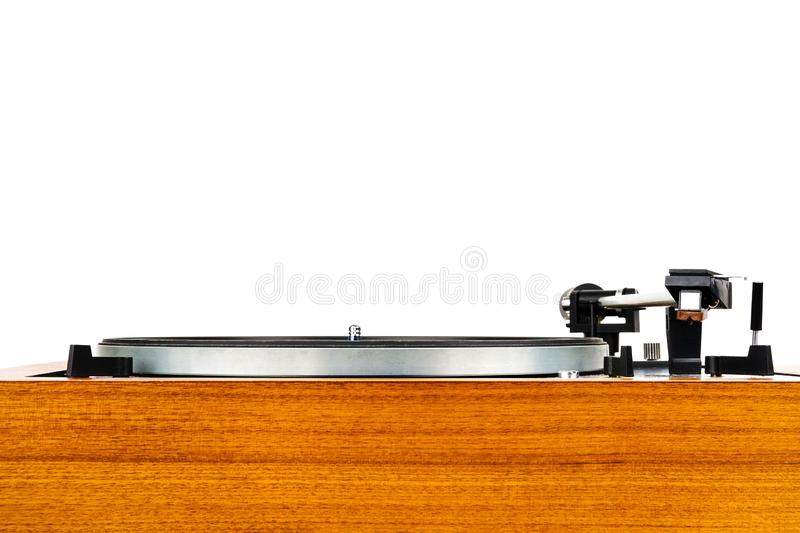 Close up of vintage turntable vinyl record player isolated on white. Wooden plinth. Retro audio equipment stock images