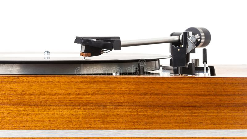 Close up of vintage turntable vinyl record player isolated on white. Wooden plinth. Retro audio equipment royalty free stock photo