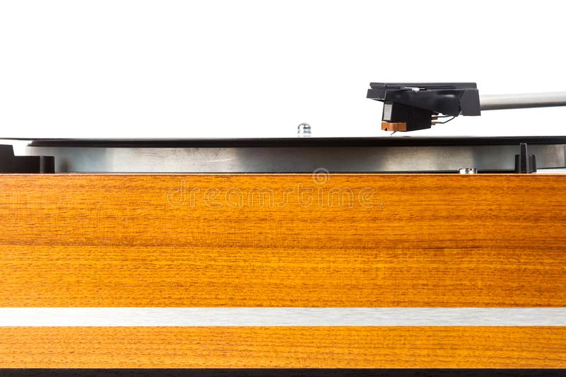 Close up of vintage turntable vinyl record player isolated on white. Wooden plinth. Retro audio equipment stock photo