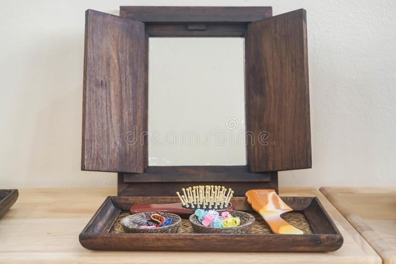 Vintage wooden mirror with comb for women beauty stock image