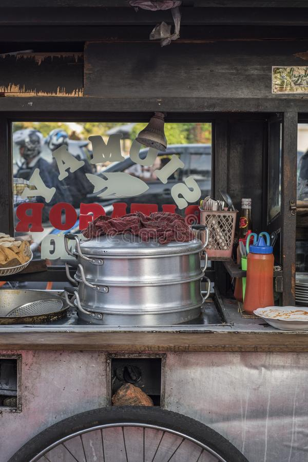 Close-up of a vintage wooden street food push cart in Jakarta, Indonesian.  stock photos
