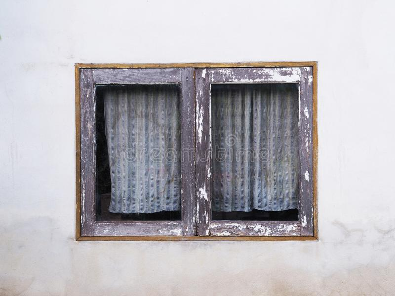 Close up vintage wooden window with old curtain stock photos
