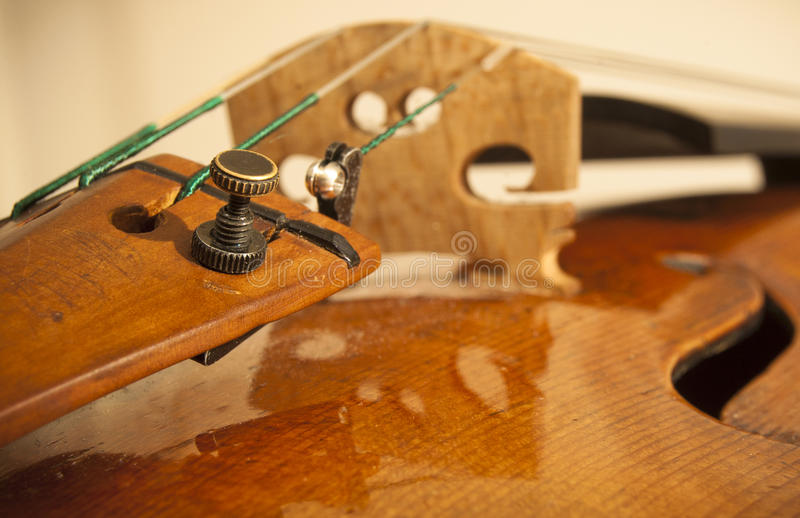 Close up on a violin. A close up on a violin with the focus on the tuner stock images