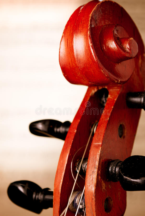 Close Up of Violin Scroll in front of Sheet Music stock photo
