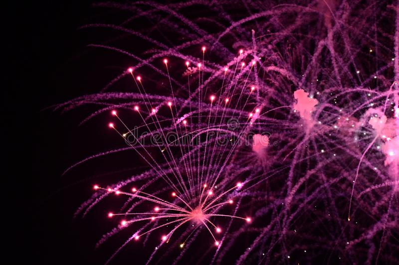 Close-up of vivid purple fireworks with sparks stock photography