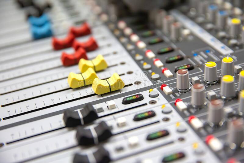 Close up Volume adjustment slides on sound audio mixer and av equipment in Studio room for recording. Sound editor,audition and entertainment events royalty free stock photos