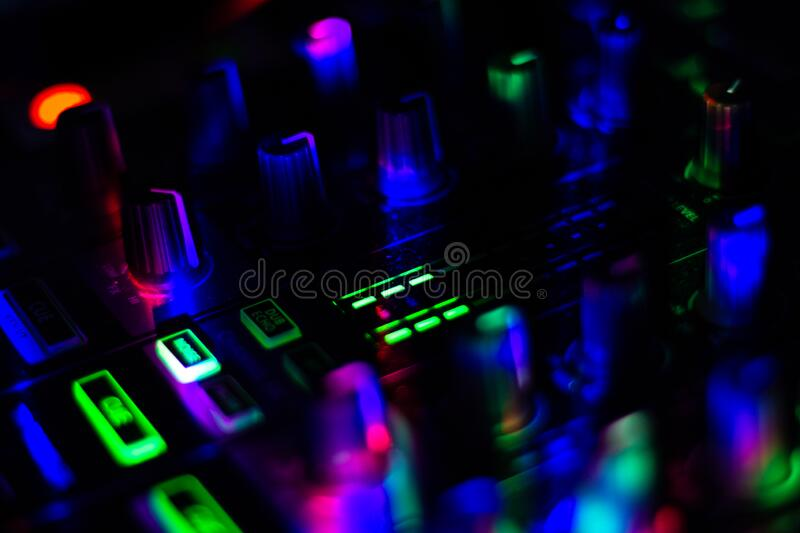 Close up of Volume level indicator of DJ mixer in club night party bright colorful buttons. Macro stock image