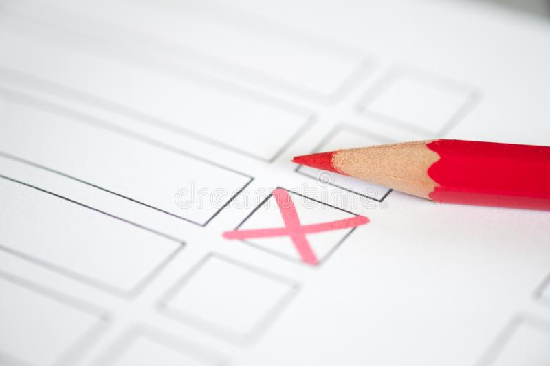 Close up voting bulletin with red pencil. Concept of election. stock photography