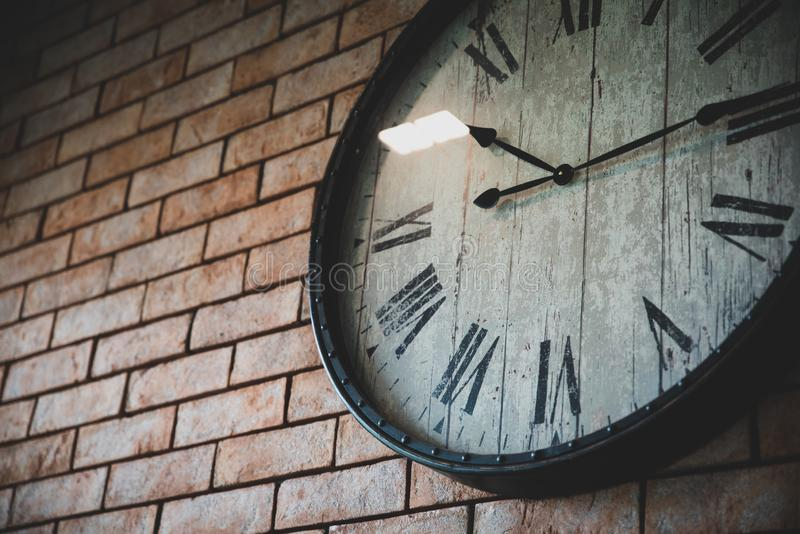 Close up wall clock vintage retro styles hanging on the brick wall stock photography