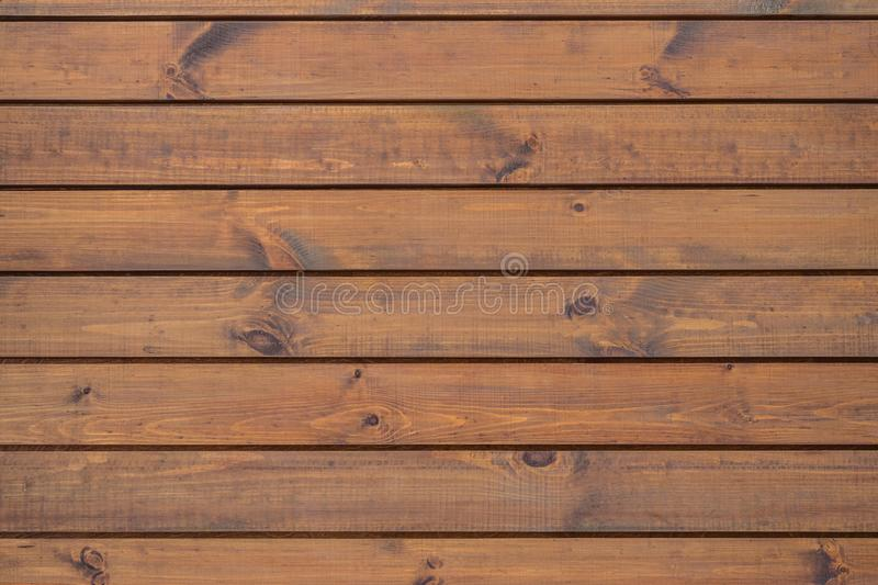 Close up of wall made of wooden planks. Wood, background, dark, plank, texture, brown, board, surface, wall, wooden royalty free stock image